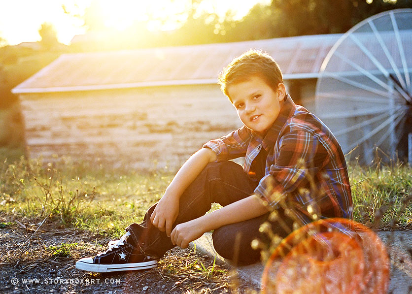 Portraits at sunset of young boy
