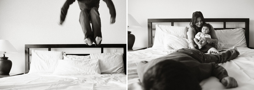 boy jumping on bed photo
